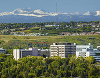 View of Calgary with mountains, city and campus